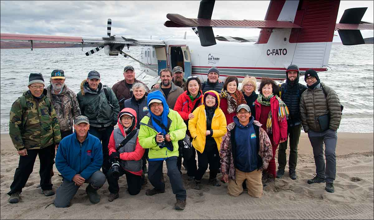 Group of photographers and support staff at Peterson's Point Lake Lodge in the Northwest Territories by Robert Berdan