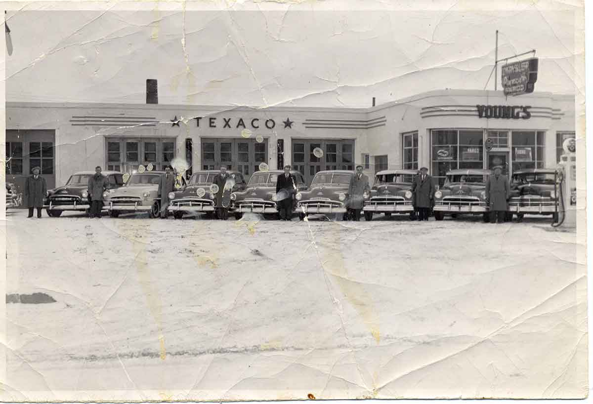 Old photo form 1950's showing car owners at Texaco by Robert Berdan
